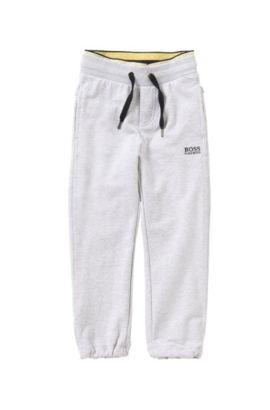 Pantalon sweat pour enfant en coton stretch avec cordon de serrage à la taille: «J24398», Gris chiné