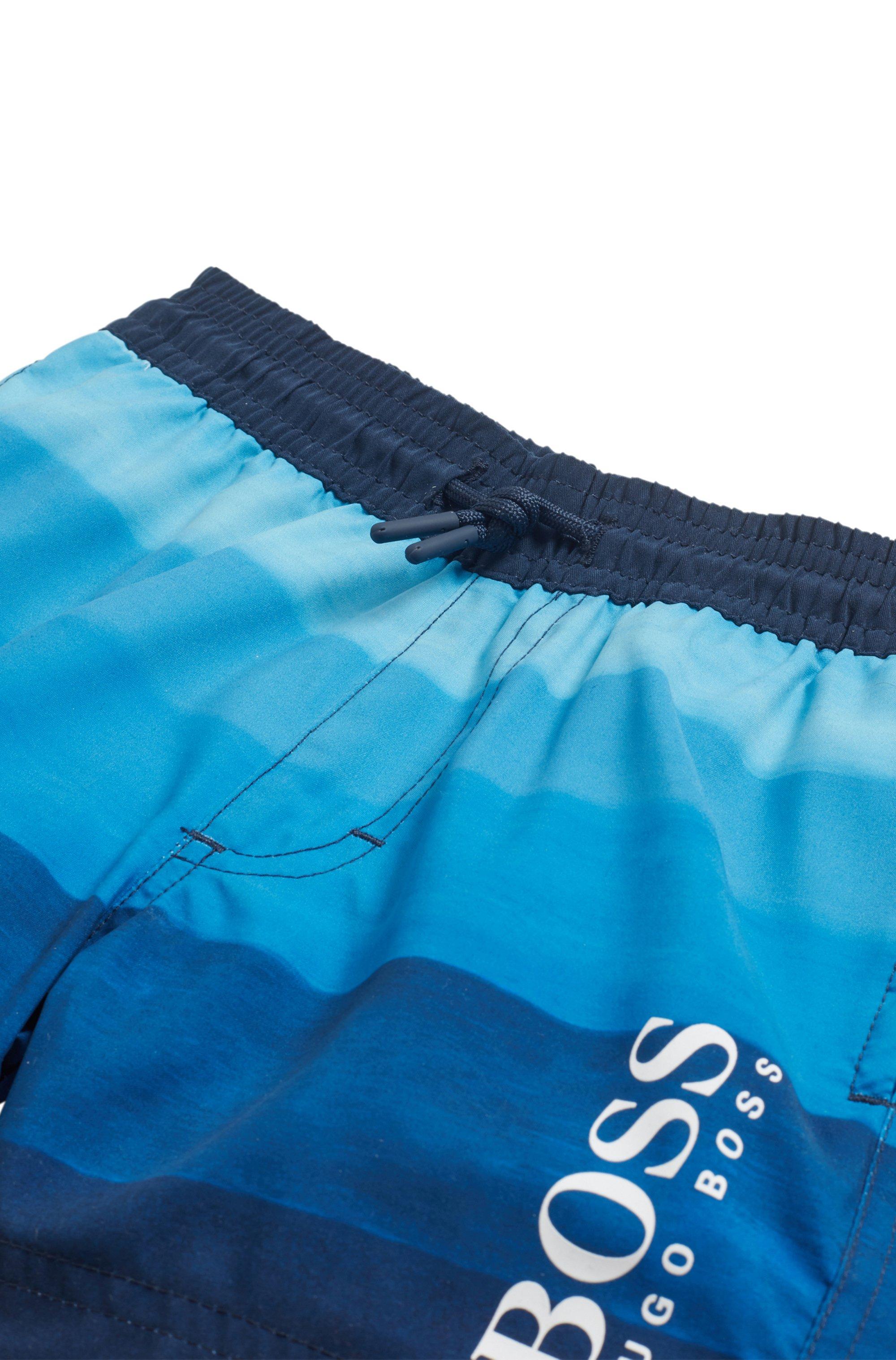 Kids' quick-drying swim shorts with degradé stripe