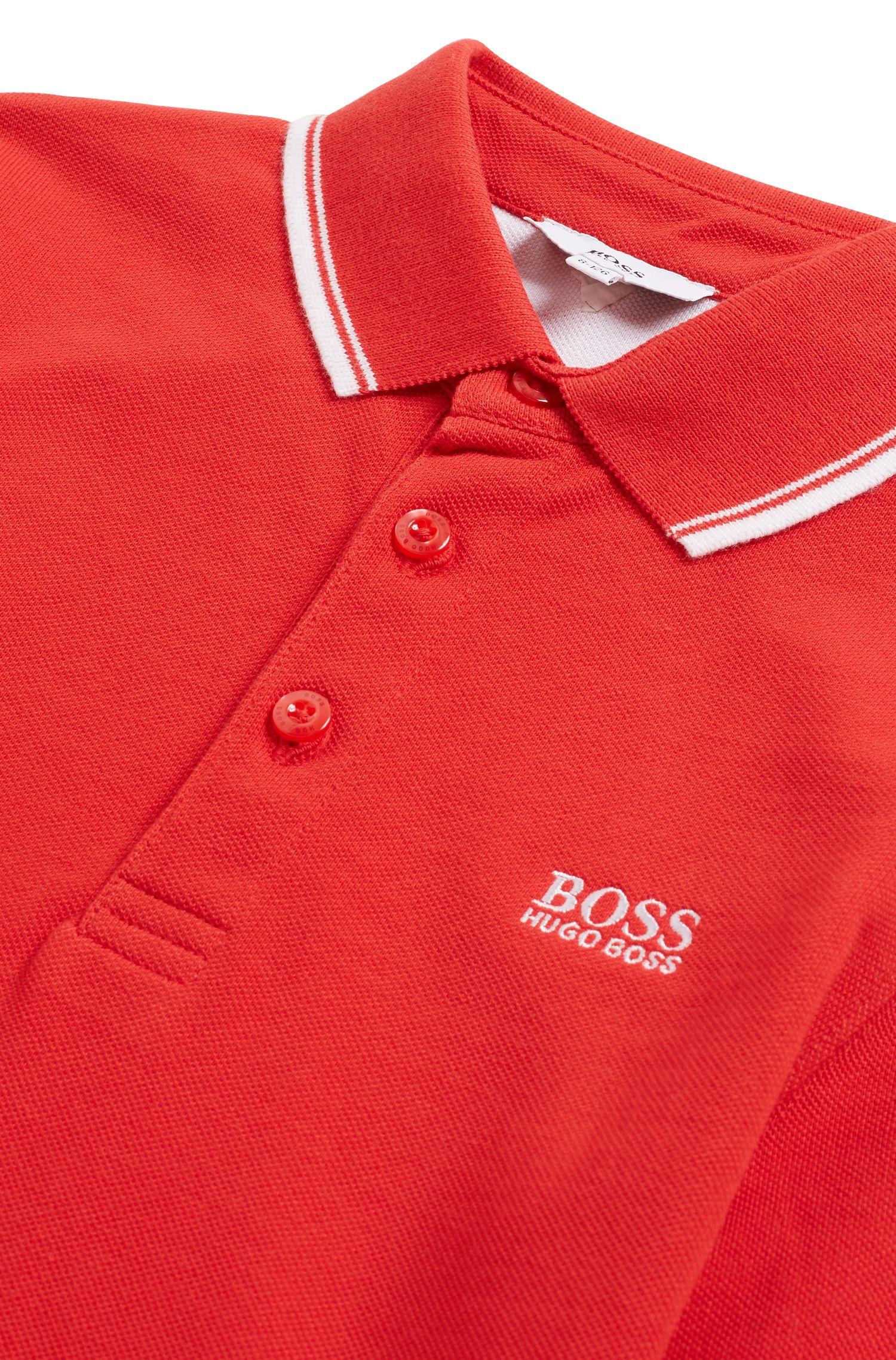 Kids-Poloshirt aus Baumwoll-Piqué mit bedruckter Kragenunterseite, Rot
