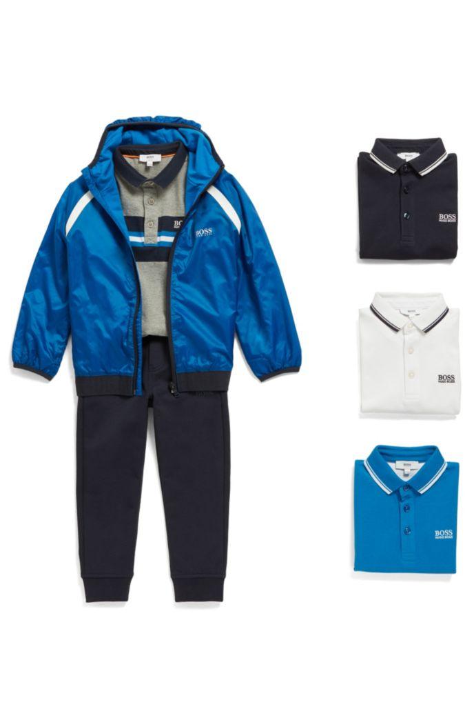 Polo pour enfant en coton chiné, avec panneau à rayures