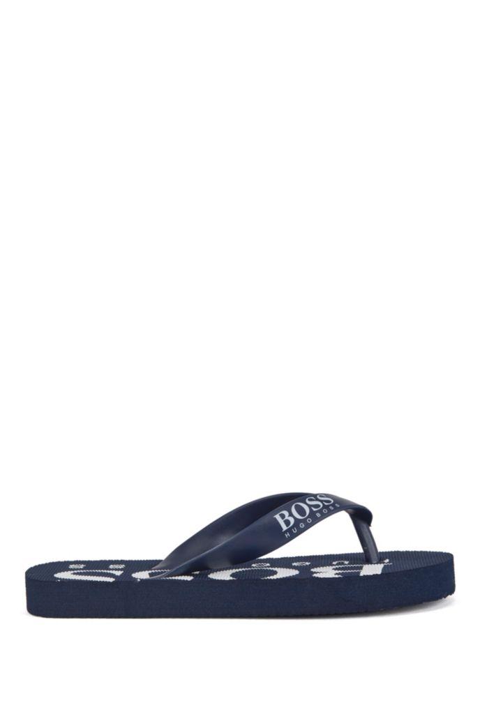 Kids' flip-flops with logo details