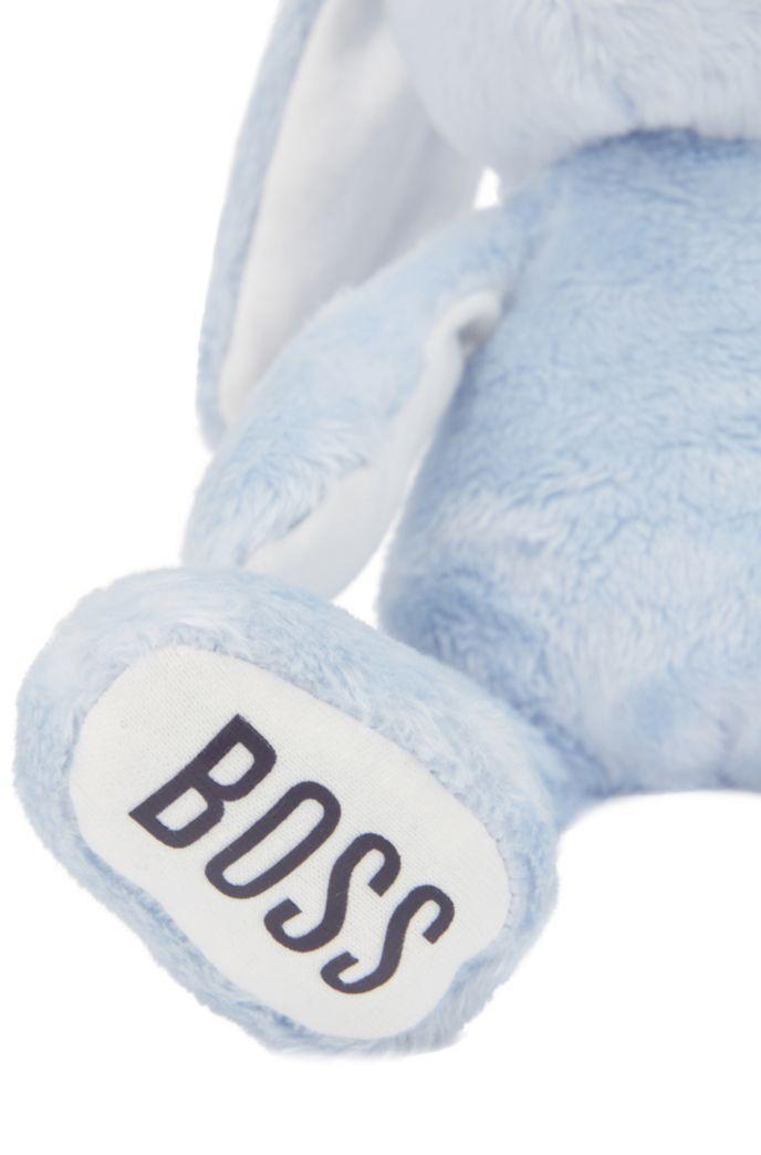 Conejito de juguete en imitación de piel con logos estampados