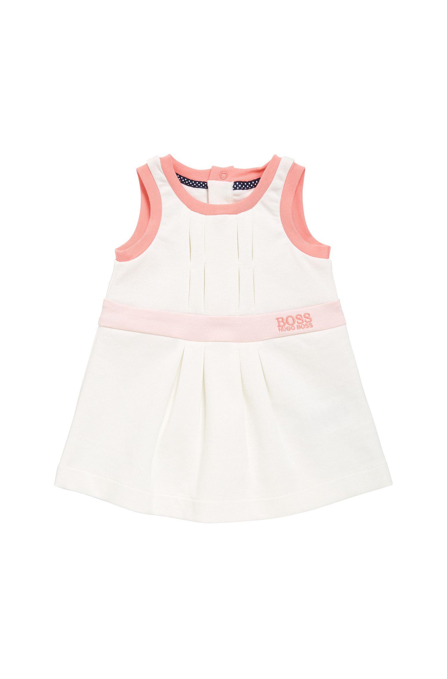 Robe pour bébé en coton, pourvue de plis: «J92029»