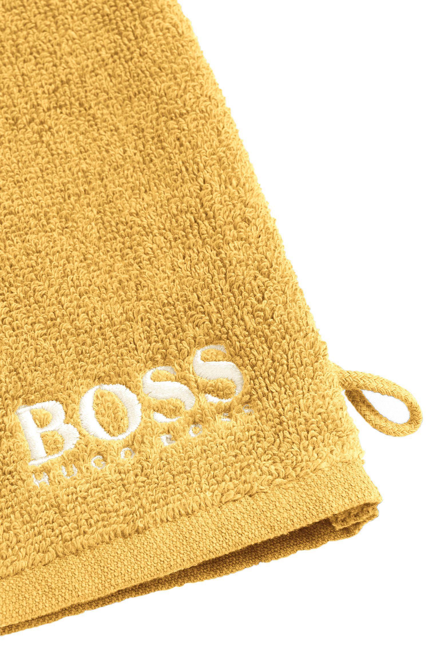 Manopla de baño en algodón egipcio de primera calidad con logo bordado en contraste