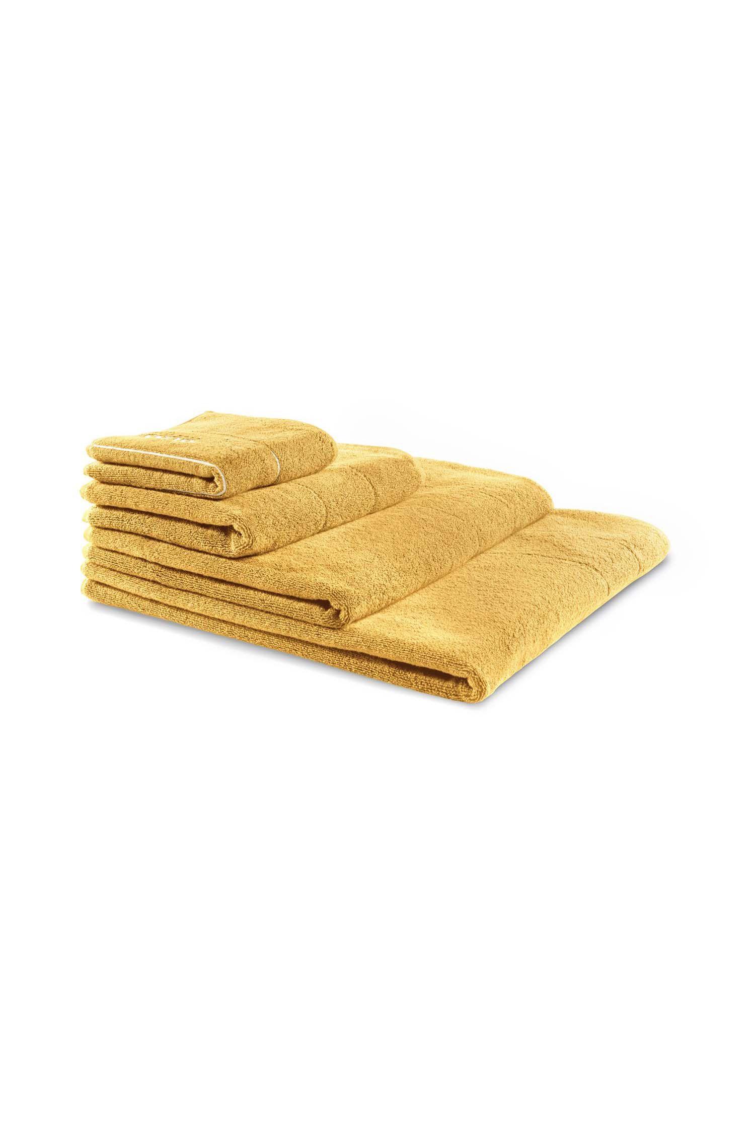 Manopla de baño en algodón egipcio de primera calidad con logo bordado en contraste, Oro