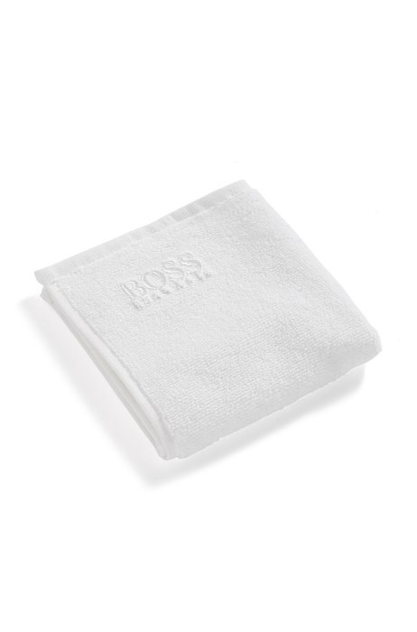 Finest Egyptian cotton face cloth with logo embroidery, White
