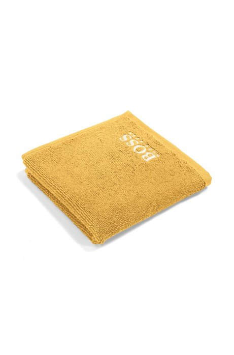 Finest Egyptian cotton face cloth with logo embroidery, Gold