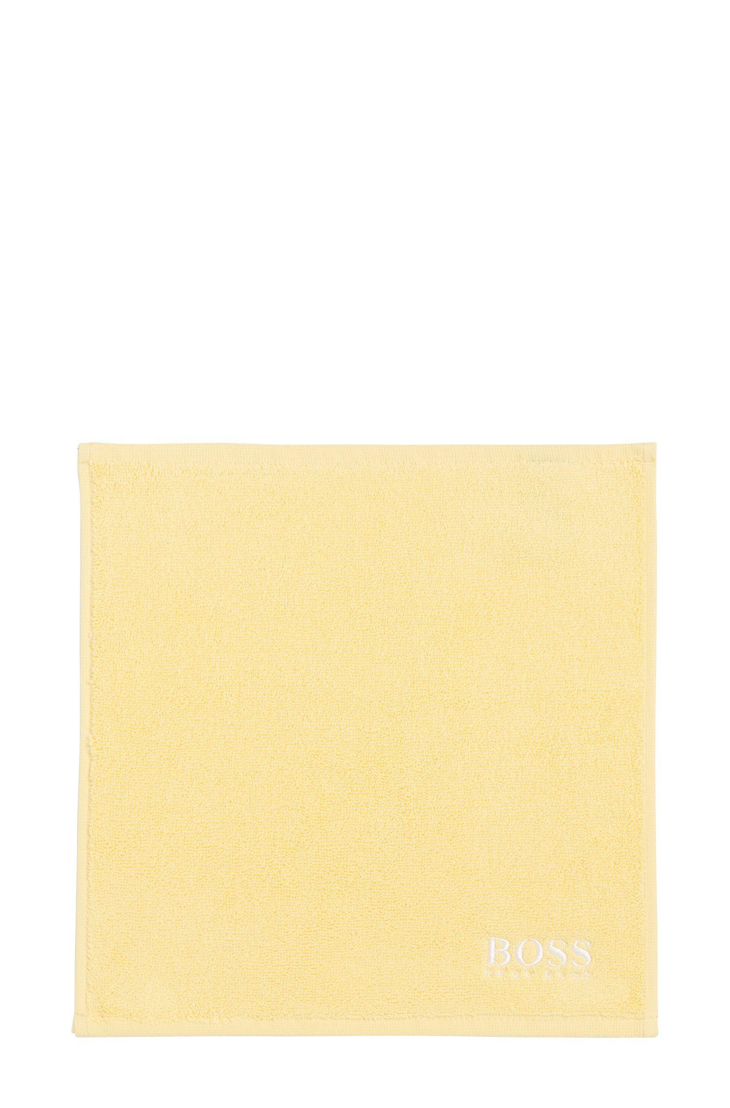 Asciugamano da viso in raffinato cotone egiziano con logo ricamato, Giallo chiaro
