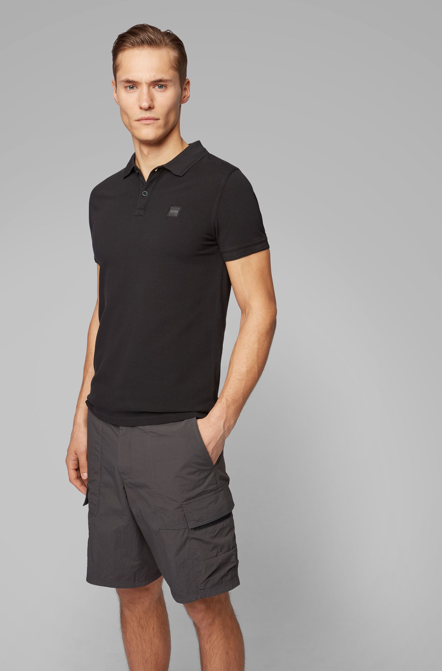Slim-fit polo shirt in washed cotton piqué, Black