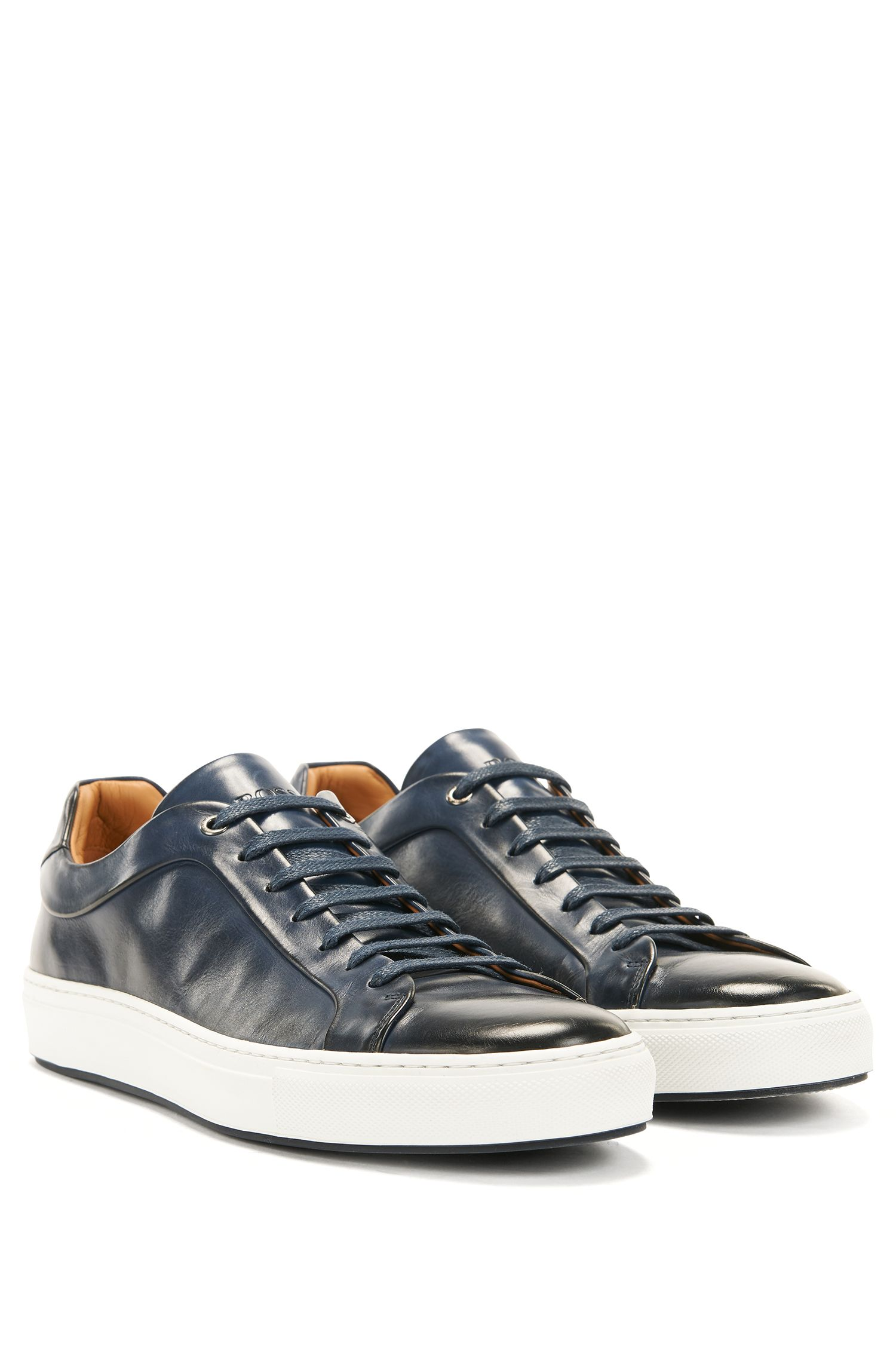 Tennis-style sneakers in burnished leather
