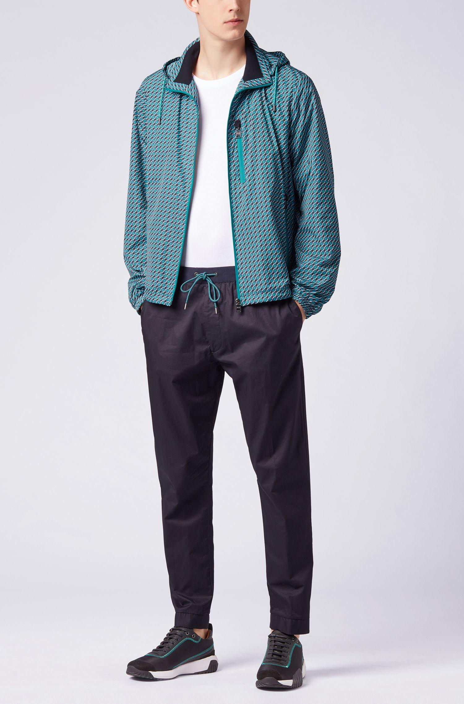 Windbreaker jacket in water-repellent fabric with geometric print