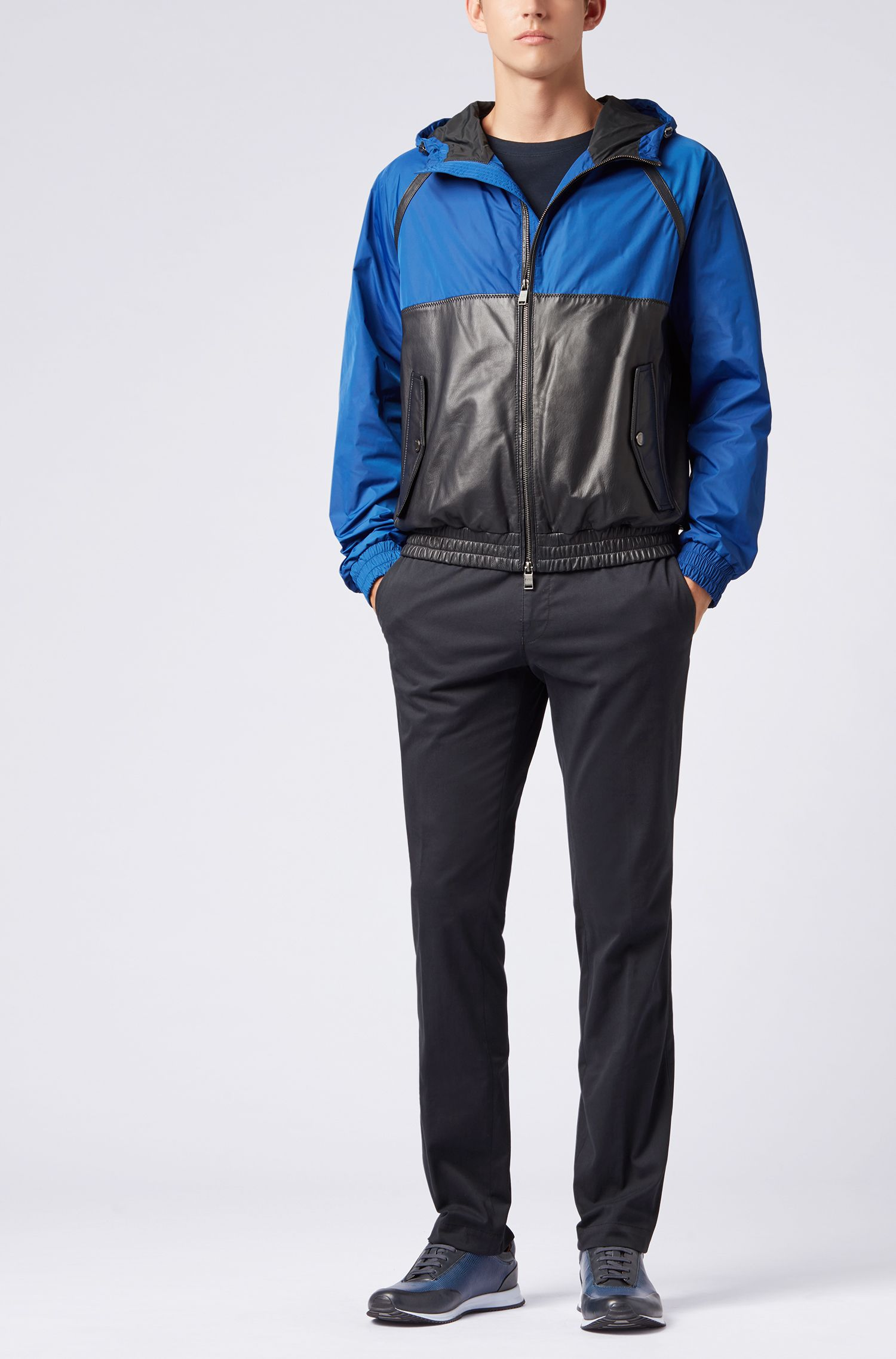 Hybrid jacket in lightweight technical fabric and leather