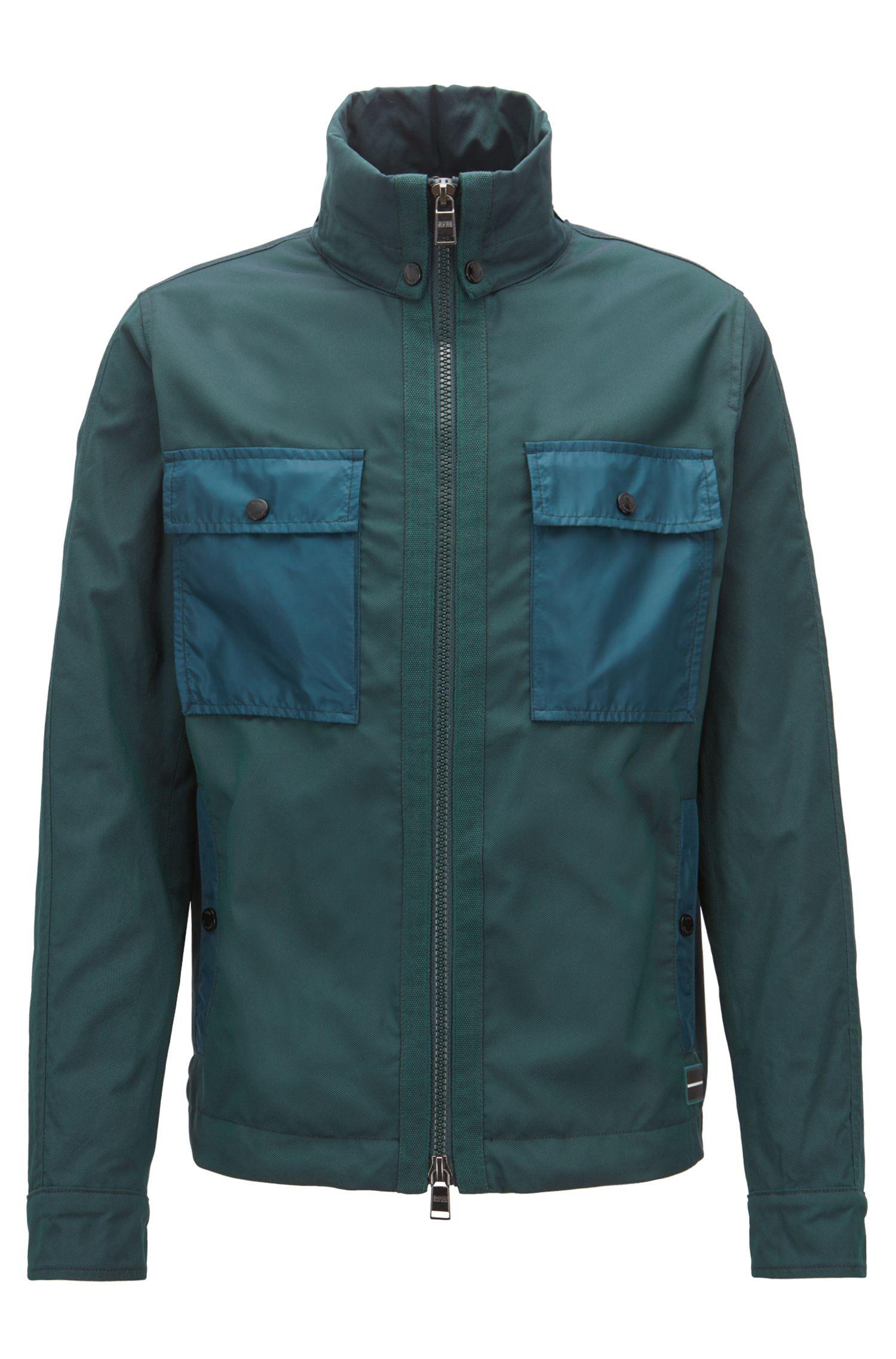 Water-repellent windbreaker jacket with stowaway hood, Dark Green