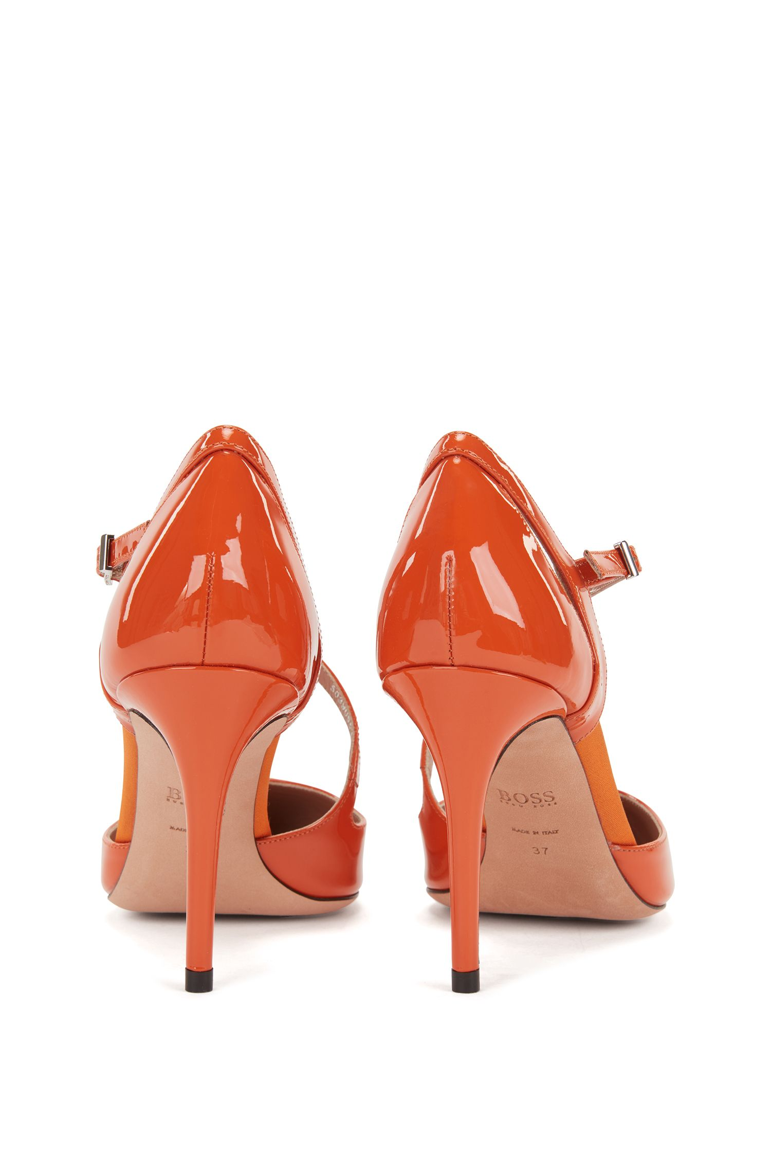 High-heeled patent-leather pumps with asymmetric strap