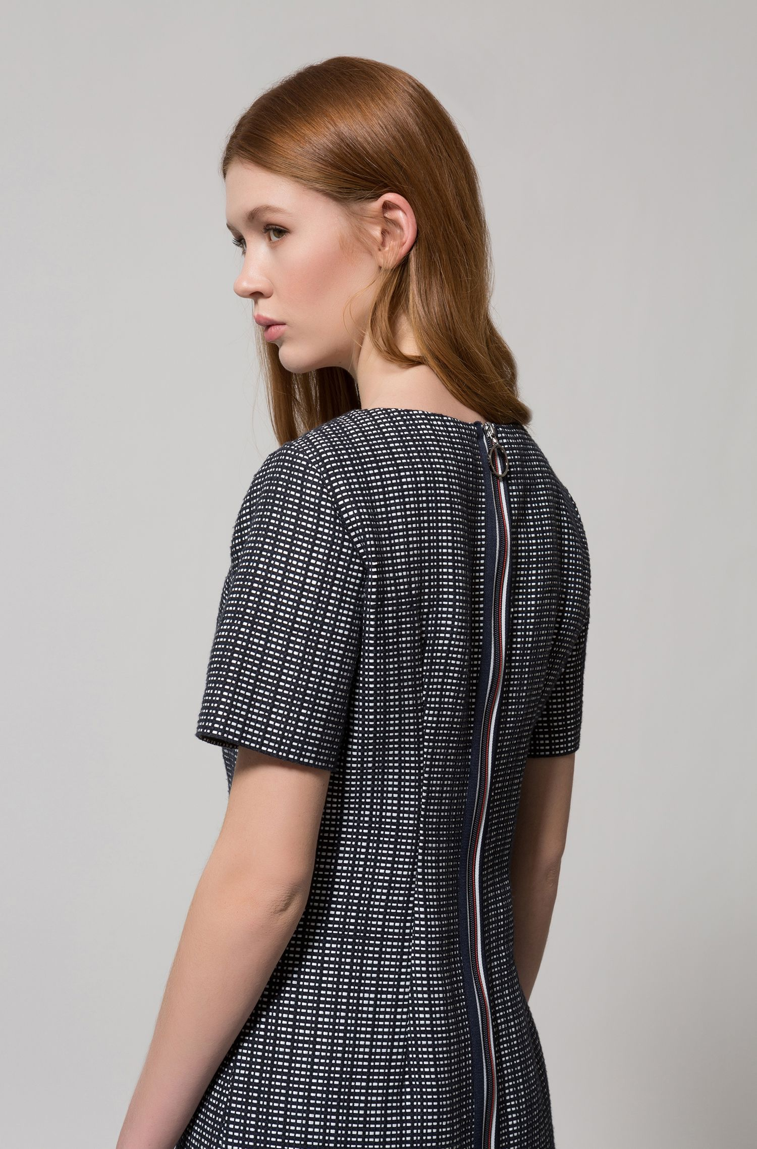 A-line dress with structured design and woven stripes