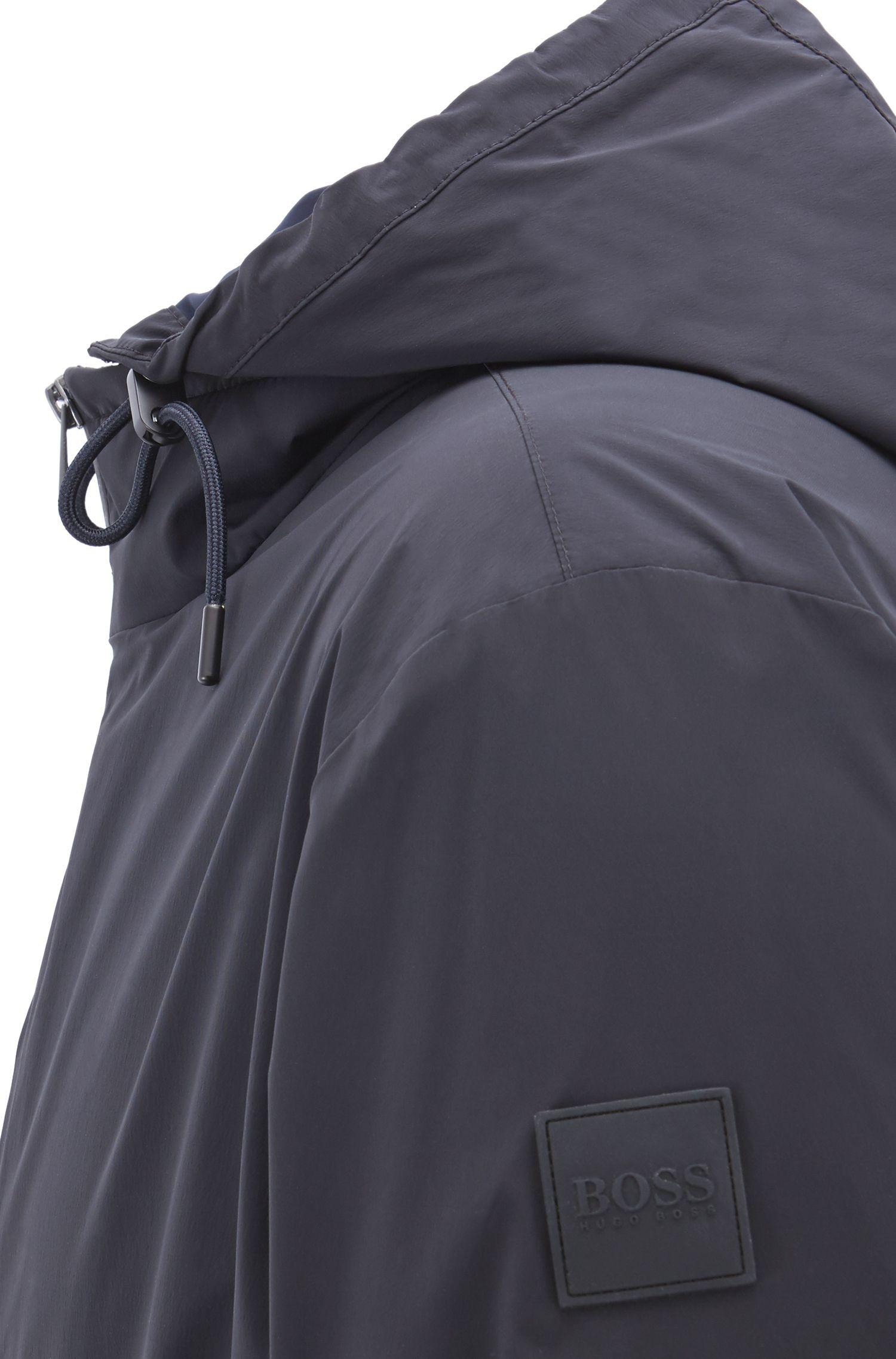 Water-repellent packable windbreaker with detachable hood
