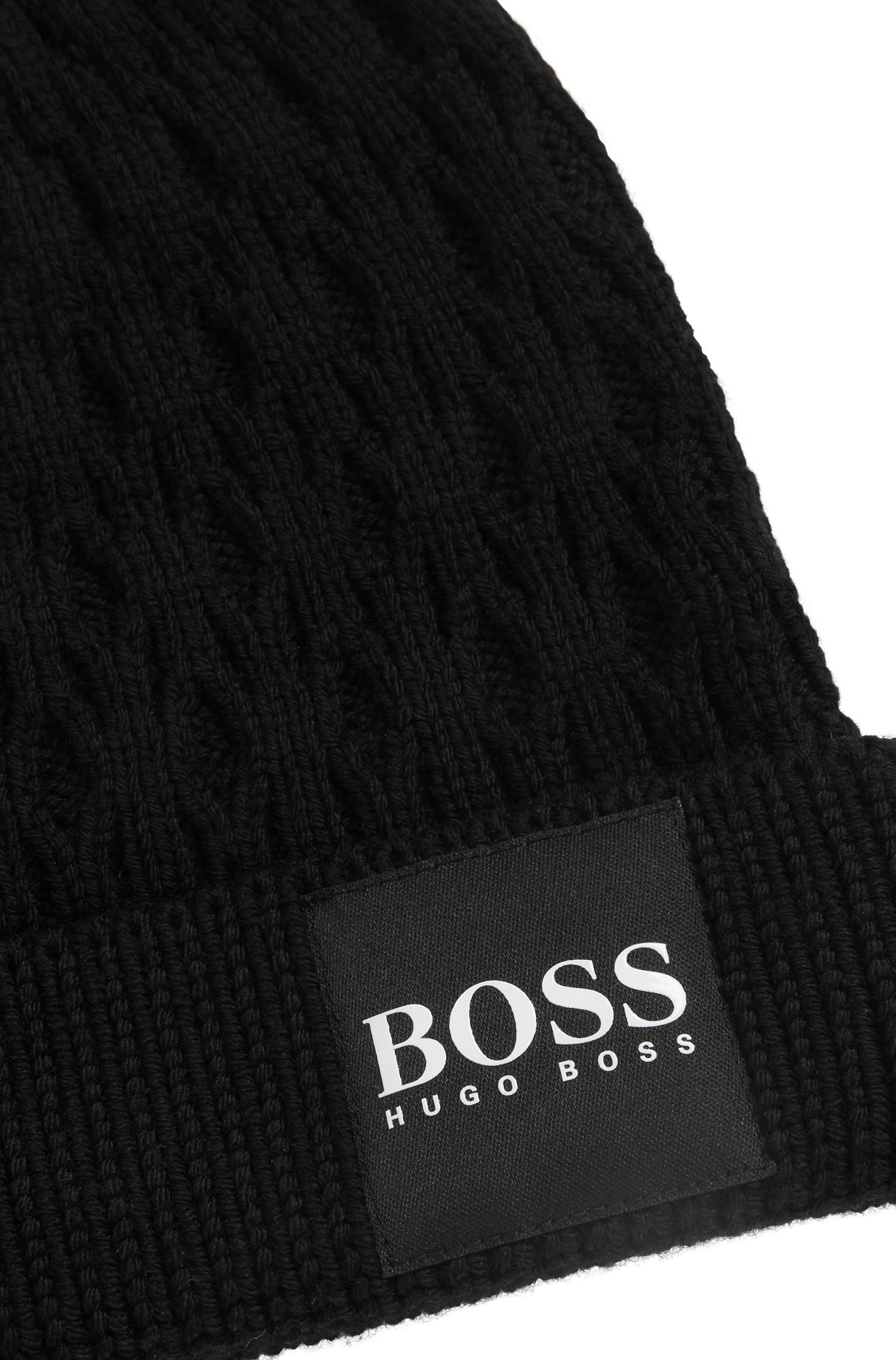 Knitted beanie hat in structured virgin wool