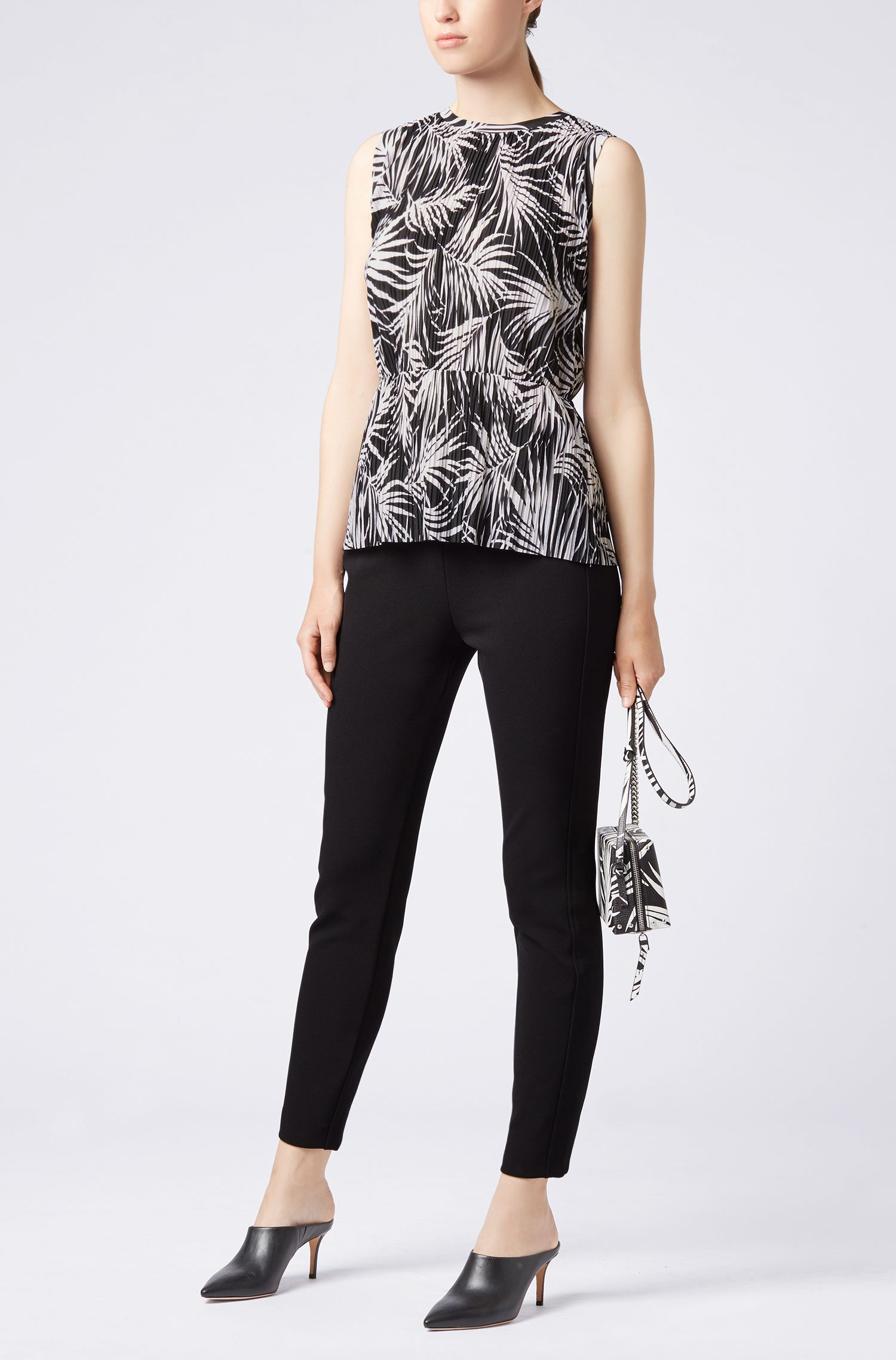 Sleeveless peplum top in printed jersey with plissé pleats, Patterned