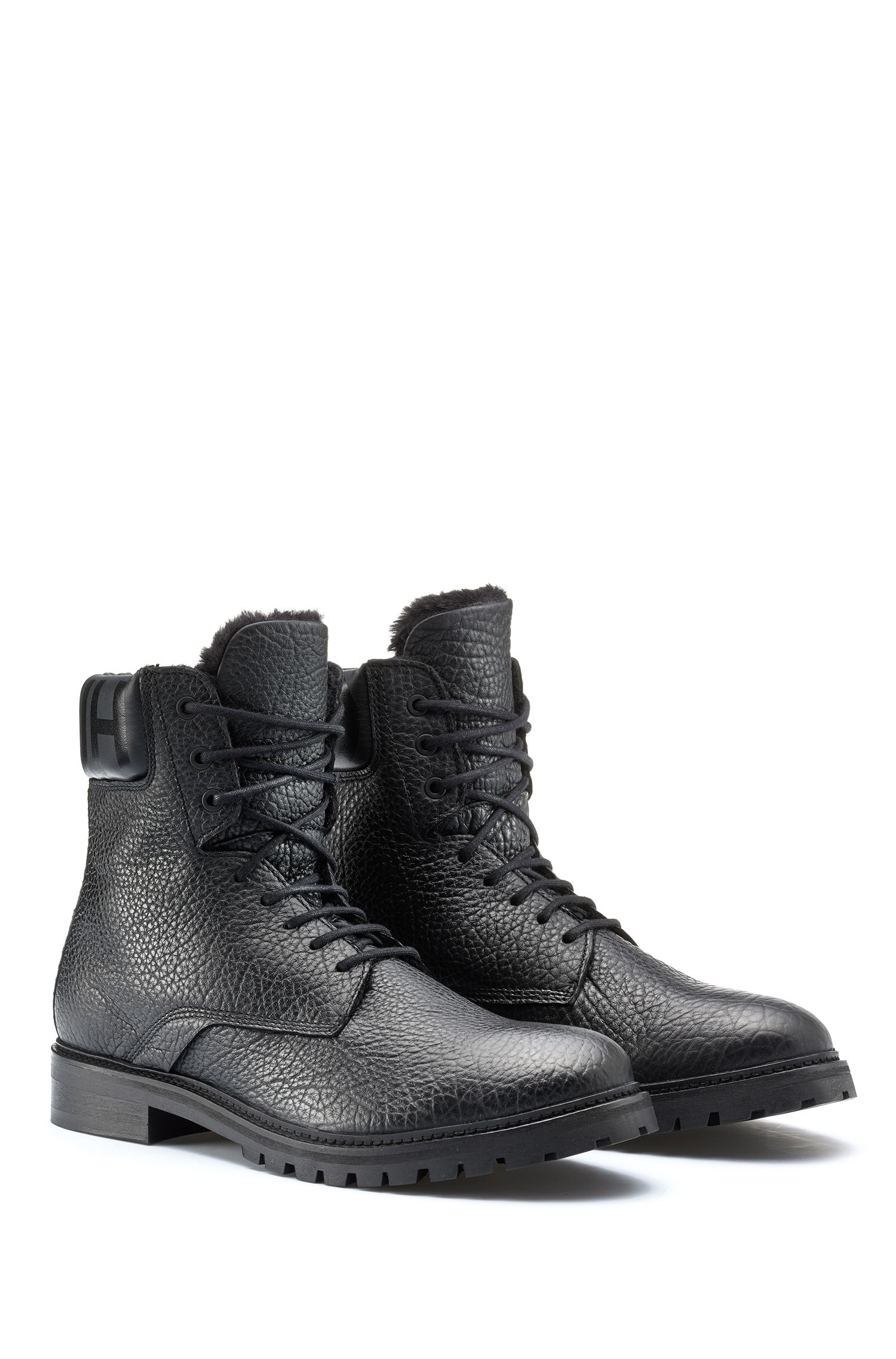 Faux-fur-lined boots in grainy leather, Black