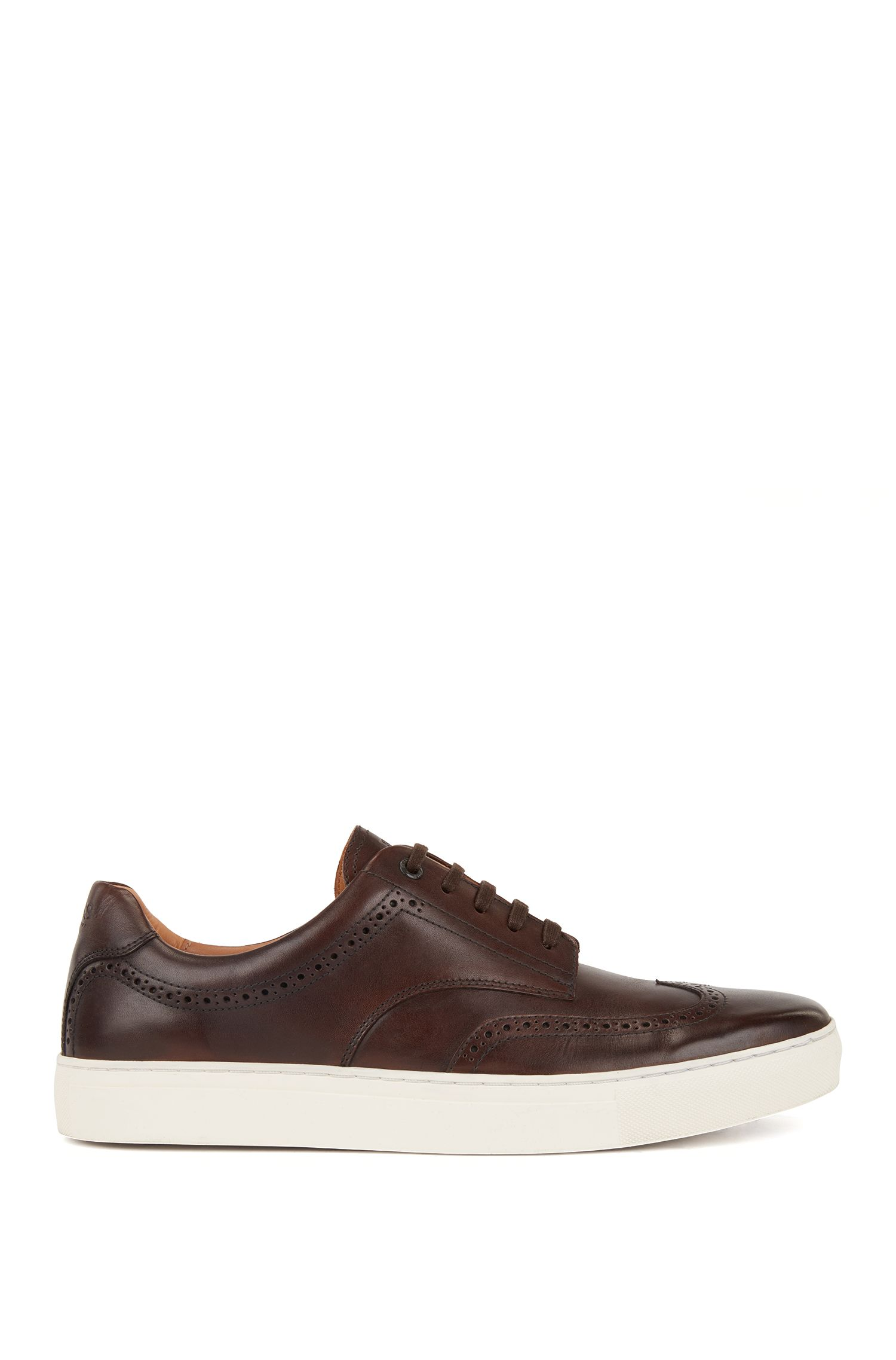 Derby-style sneakers in calf leather with brogue details, Brown
