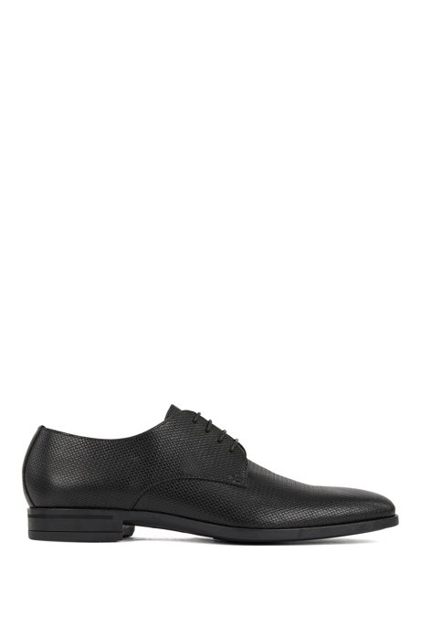 Derby shoes in monogram-embossed leather, Black