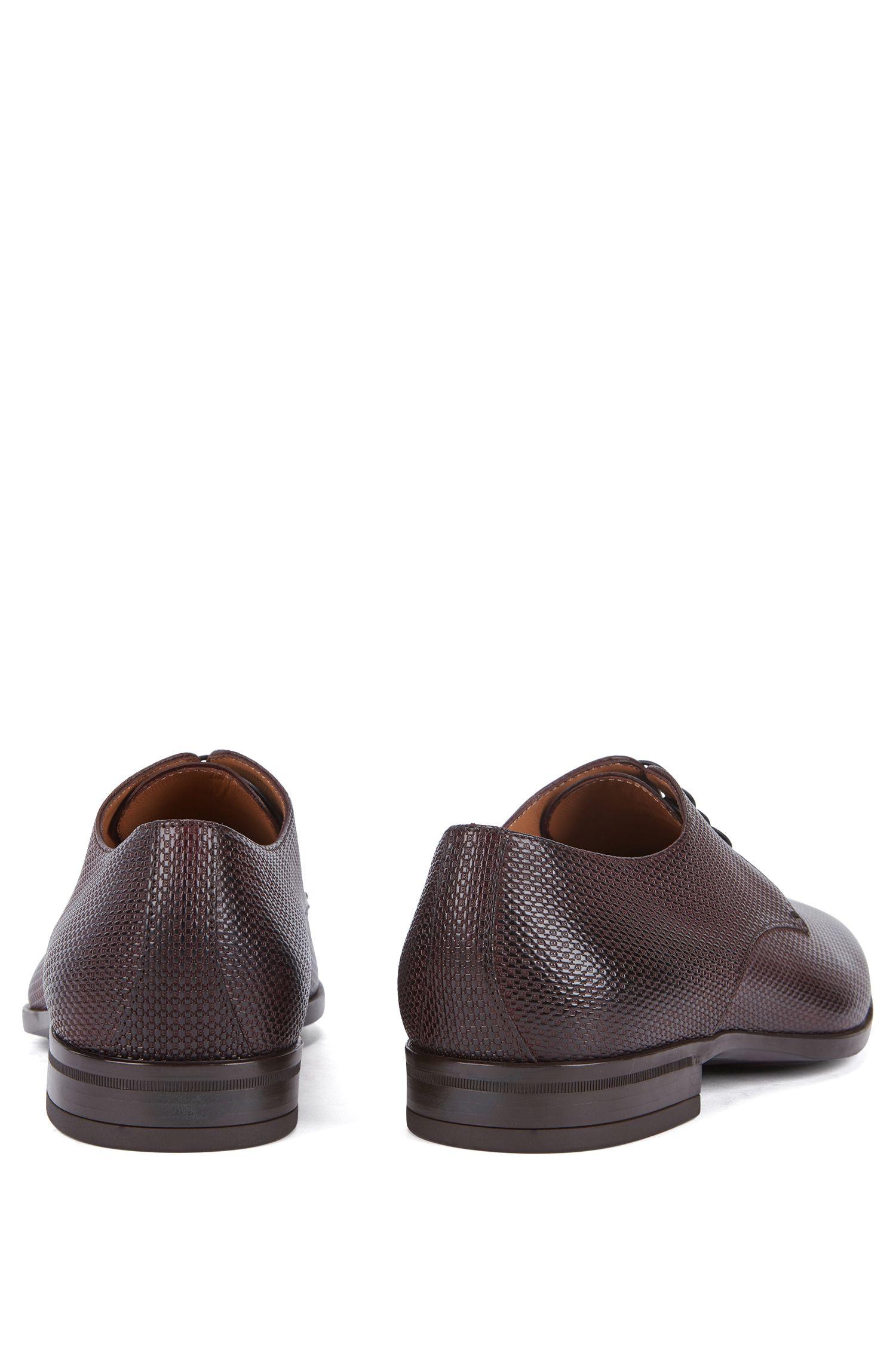 Derby shoes in monogram-embossed leather, Dark Red