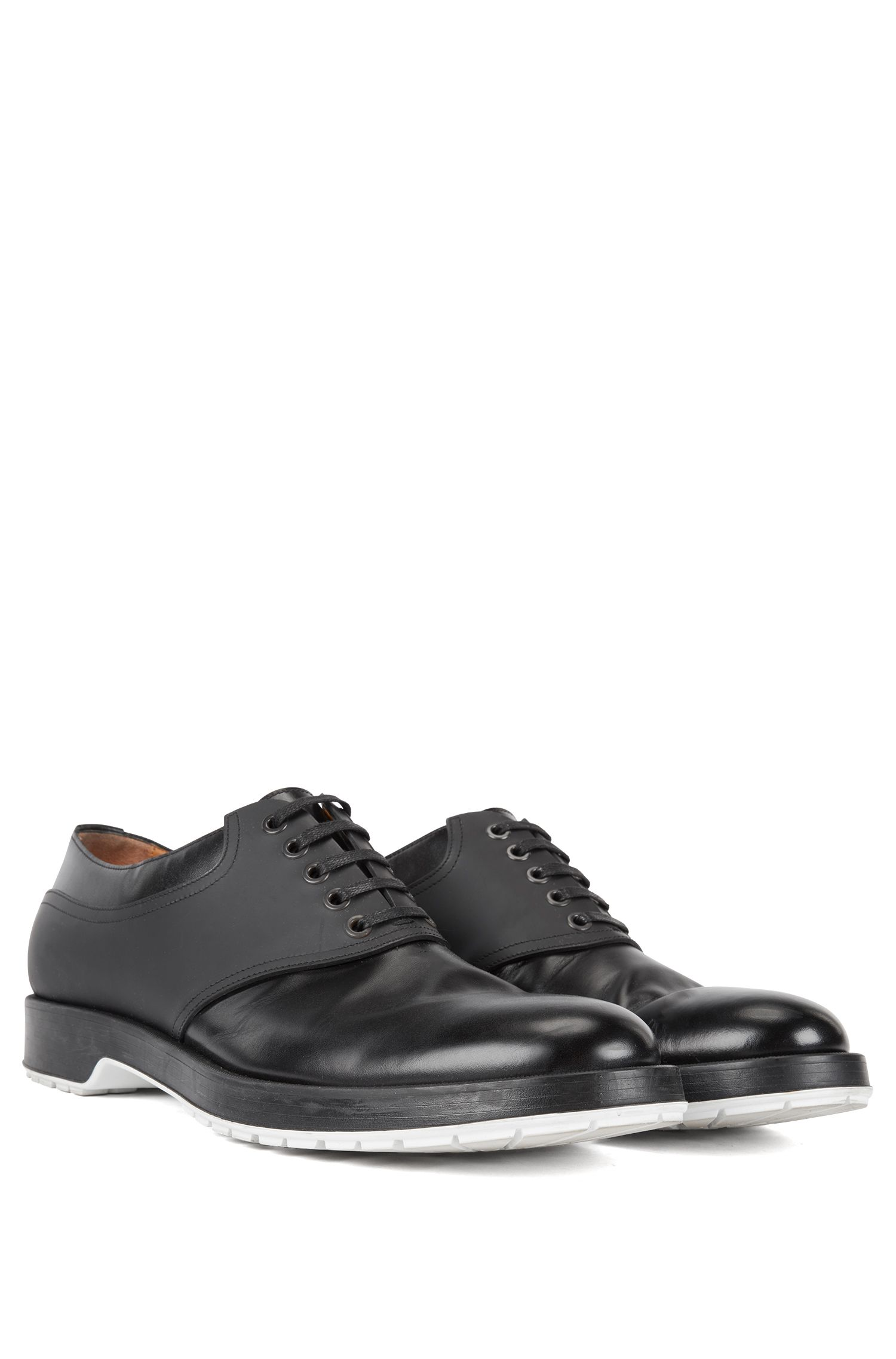Derby shoes in brush-off leather with rubberized detail, Black