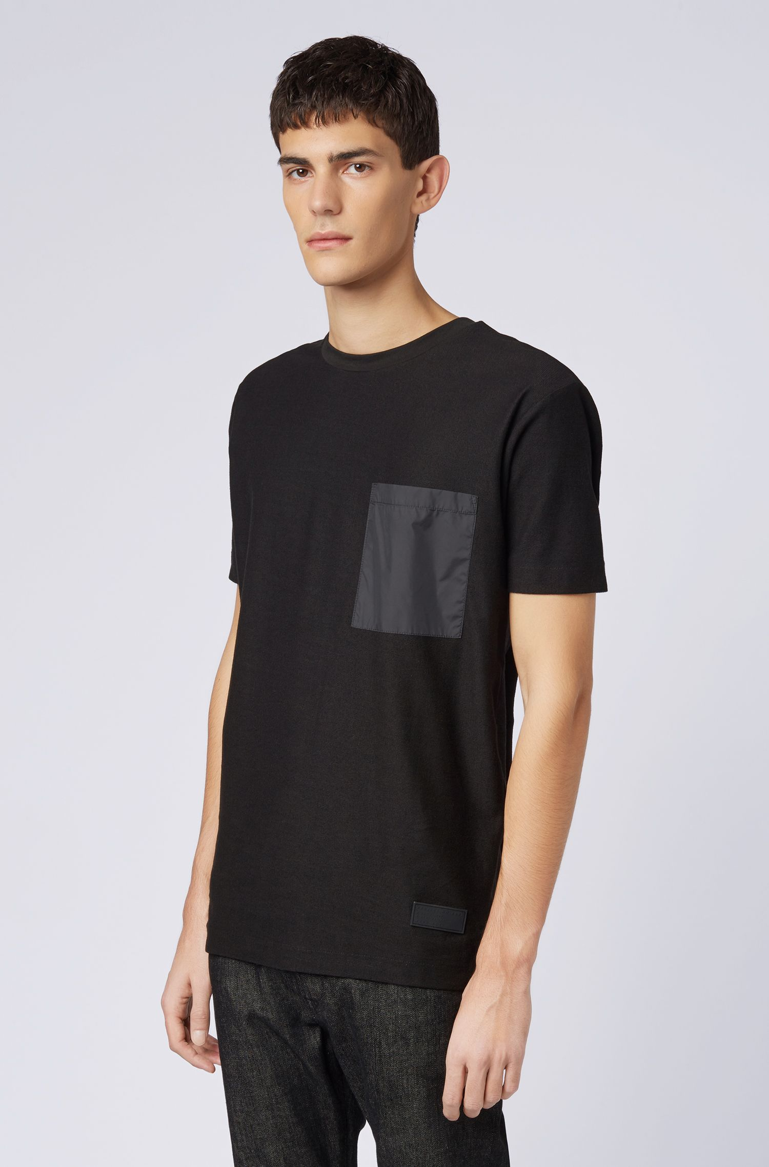 Relaxed-fit T-shirt in cotton with technical pocket detail, Black