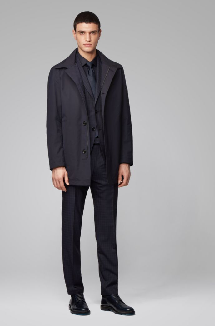 Water-repellent automobile coat with stowaway hood