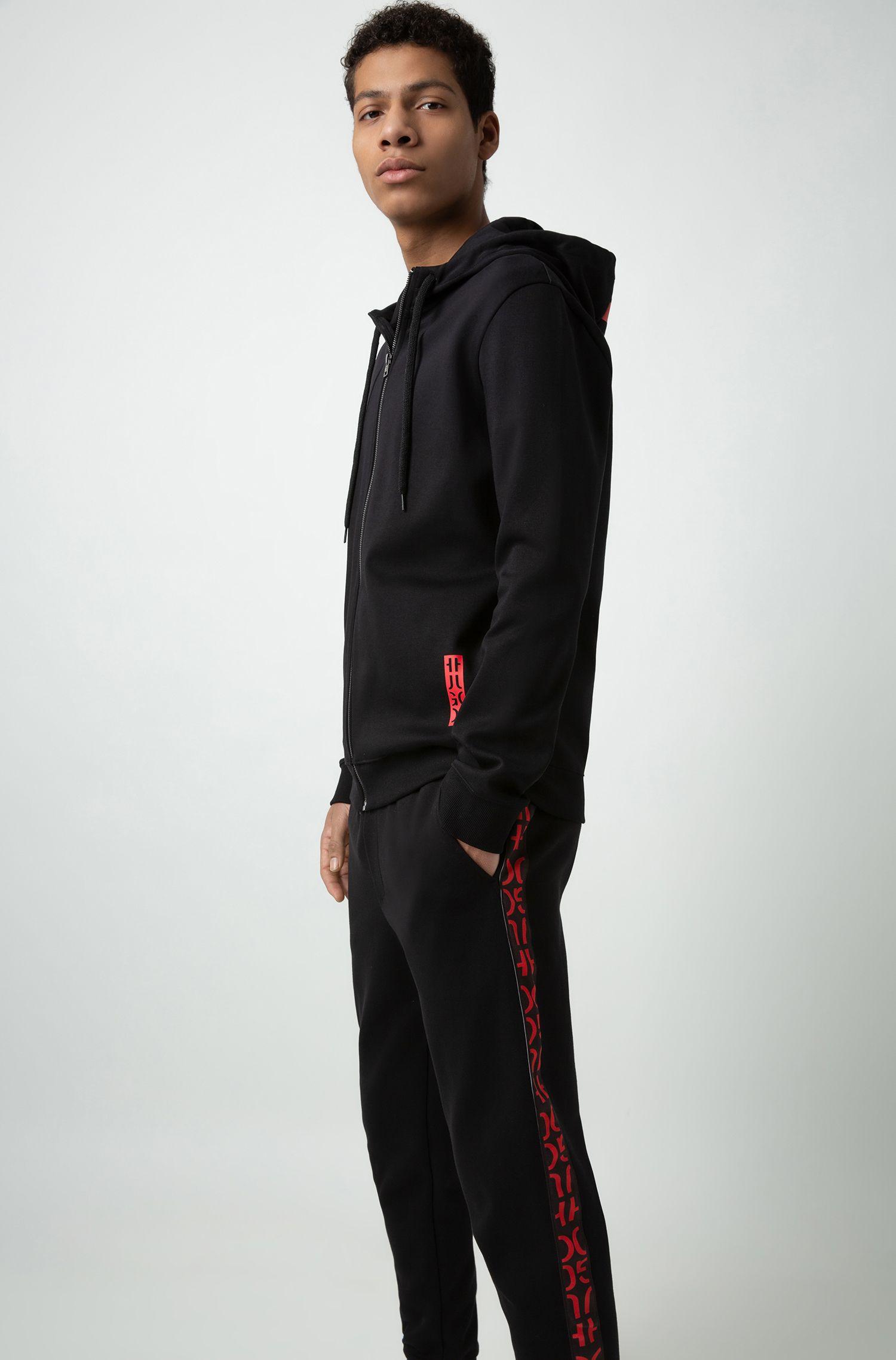 Cuffed interlock-cotton jogging pants with logo-interpretation tape, Black