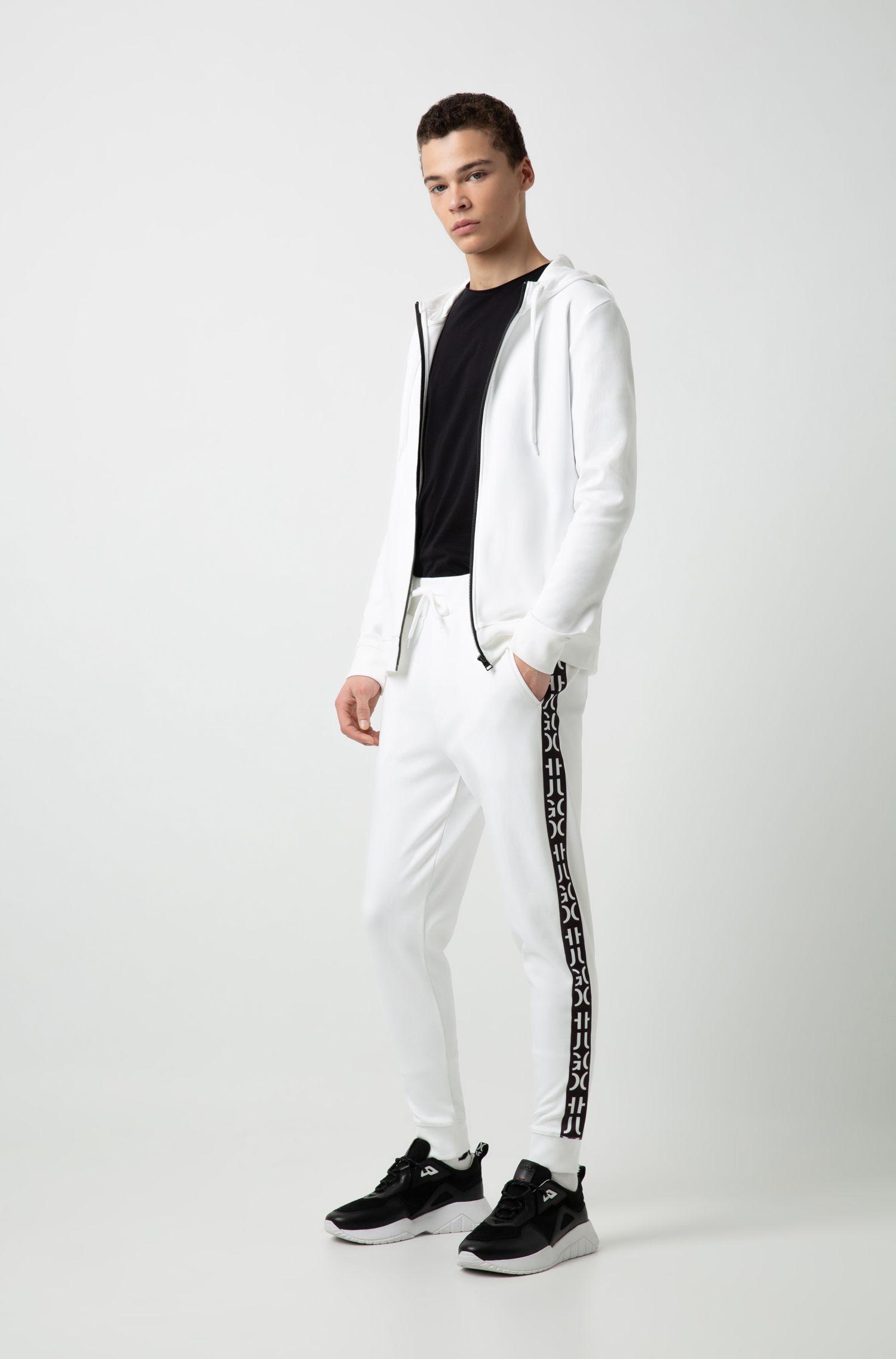 Cuffed interlock-cotton jogging pants with logo-interpretation tape, White