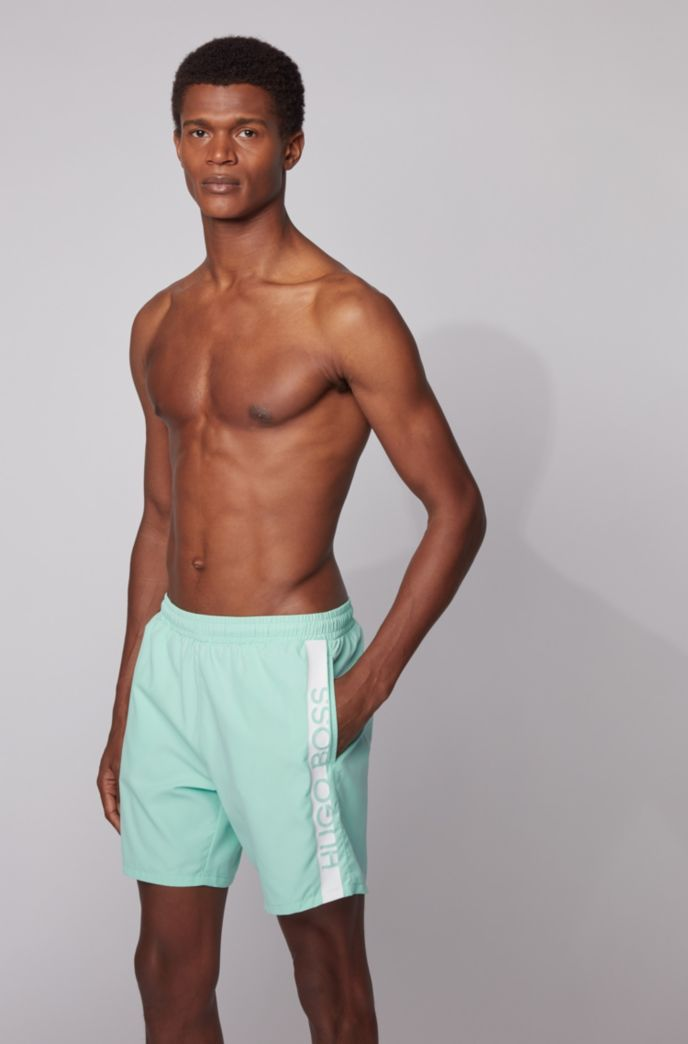 Medium-length swim shorts with heat-sealed logo print