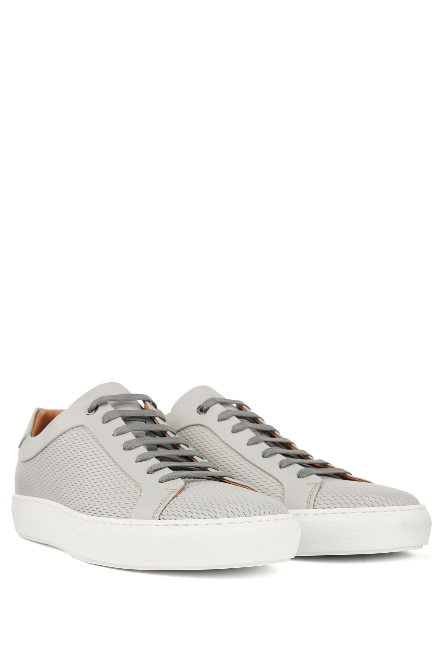 Tennis-inspired sneakers in leather with laser-cut detailing, Light Grey