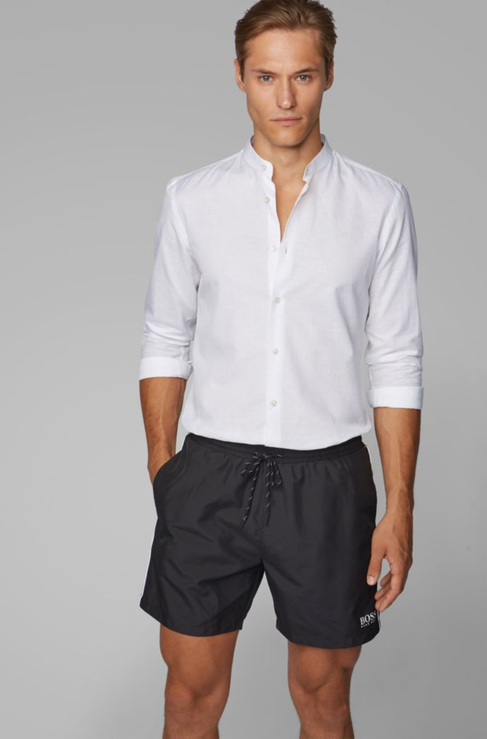 Medium-length swim shorts in quick-dry fabric