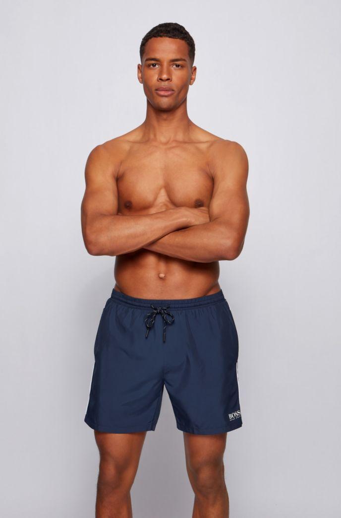 Medium-length swim shorts in quick-dry fabric