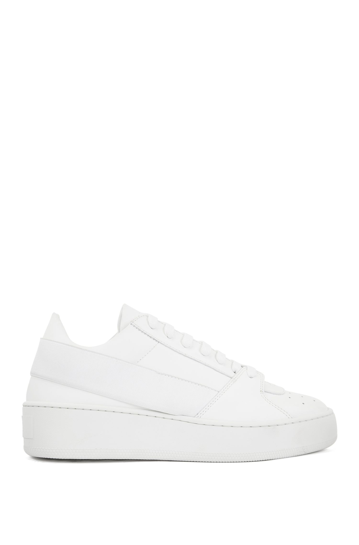 Low-cut sneakers in rubberized leather, White