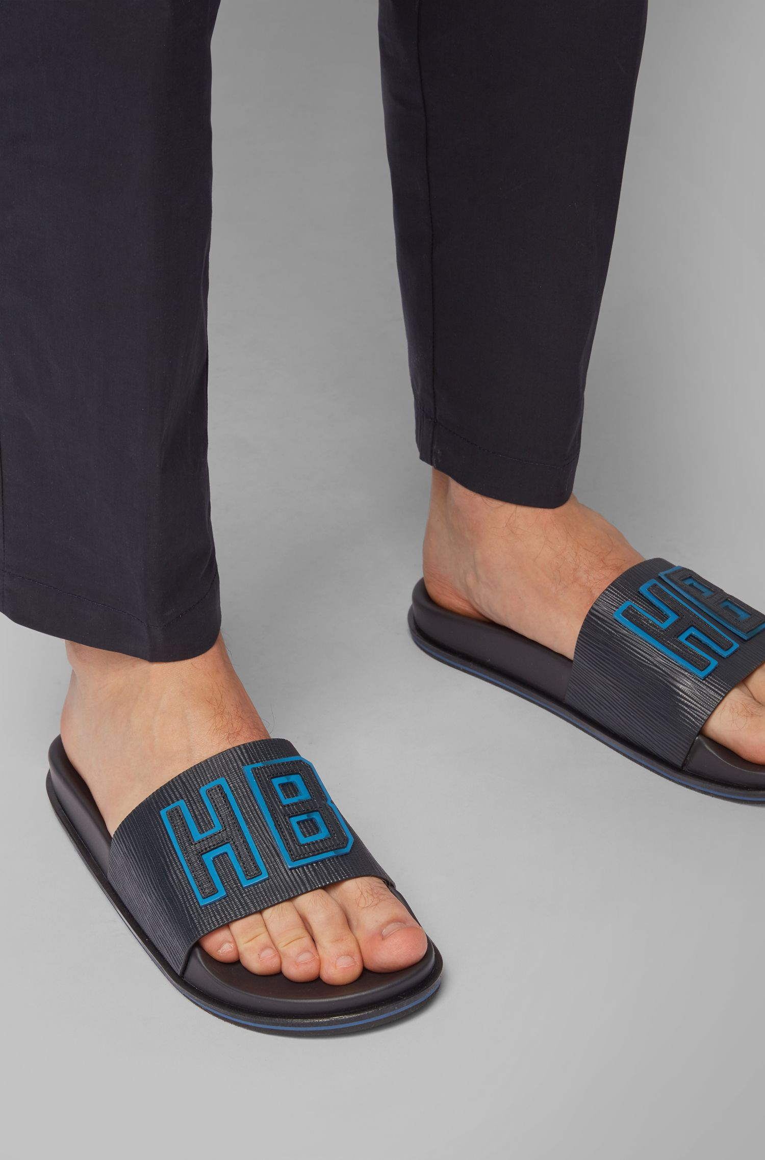 Italian-made slides in embossed leather with raised logo, Dark Blue