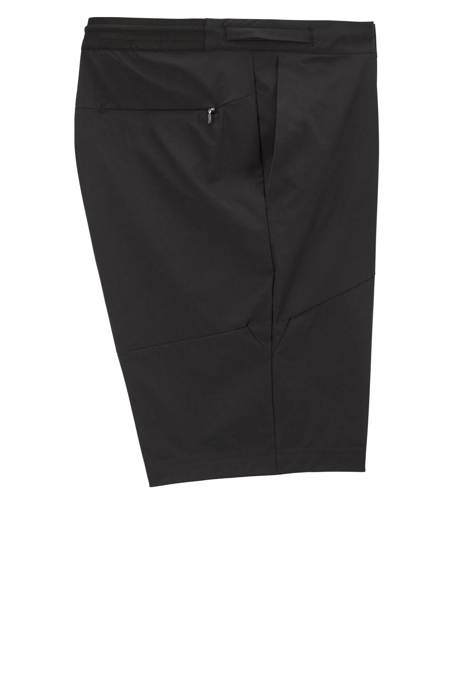 Multi-purpose slim-fit shorts in microstructured stretch fabric, Black