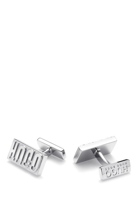 Reinterpreted reverse-logo cufflinks in polished brass, Silver