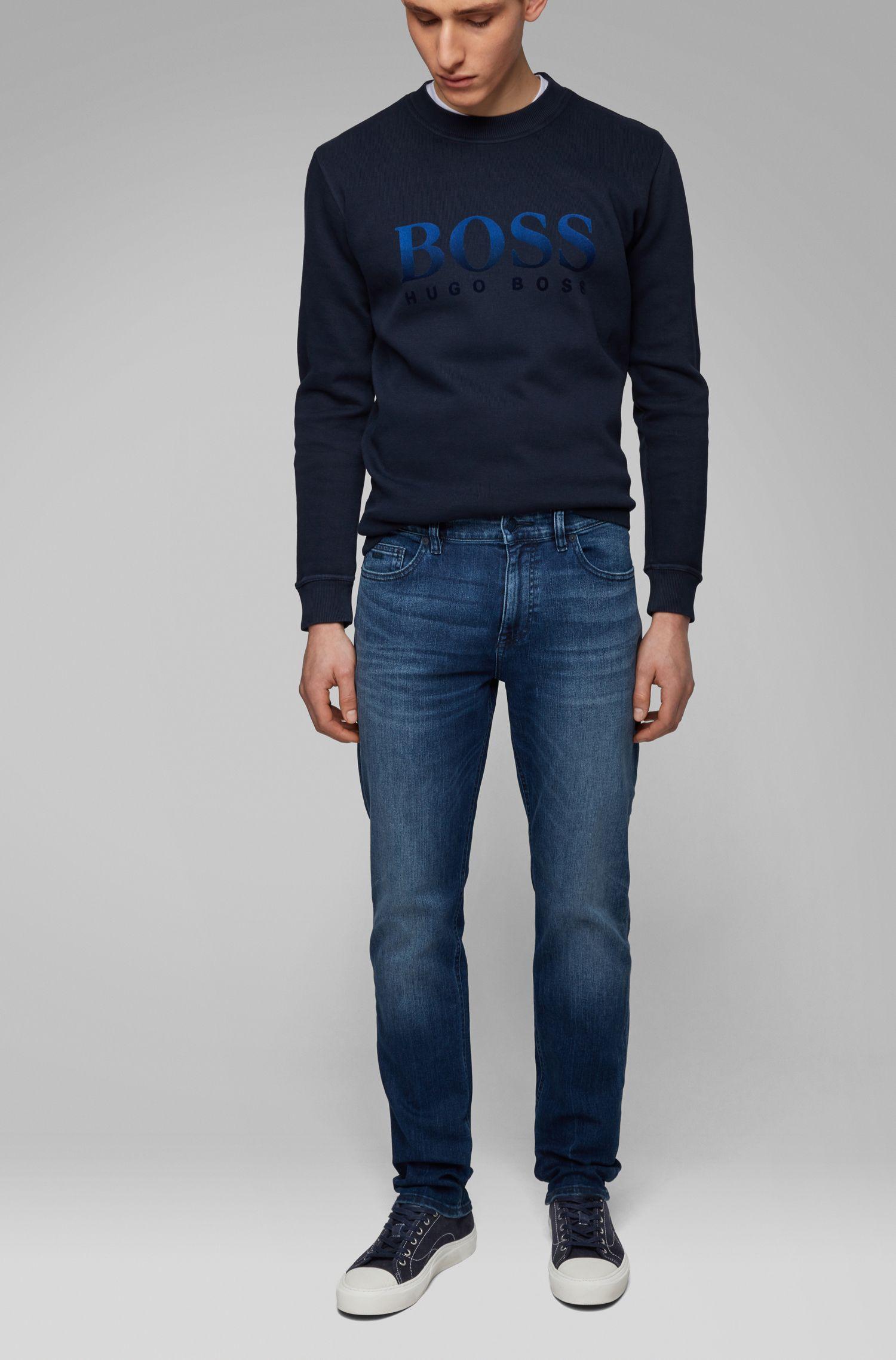 Slim-fit jeans in distressed super-stretch denim, Blue