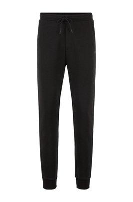 Slim-fit jogging pants with layered logo, Black