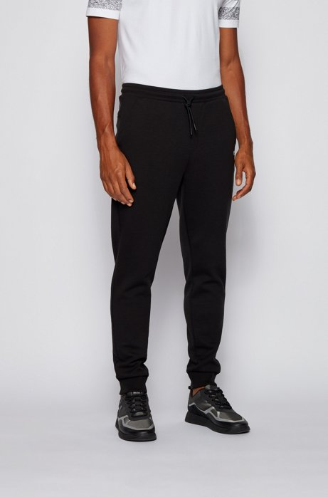 Slim-fit jogging pants with layered logo, Black