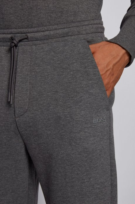 Slim-fit jogging pants with layered logo, Grey