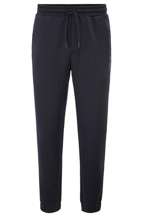 Slim-fit jogging pants with logo artwork, Black