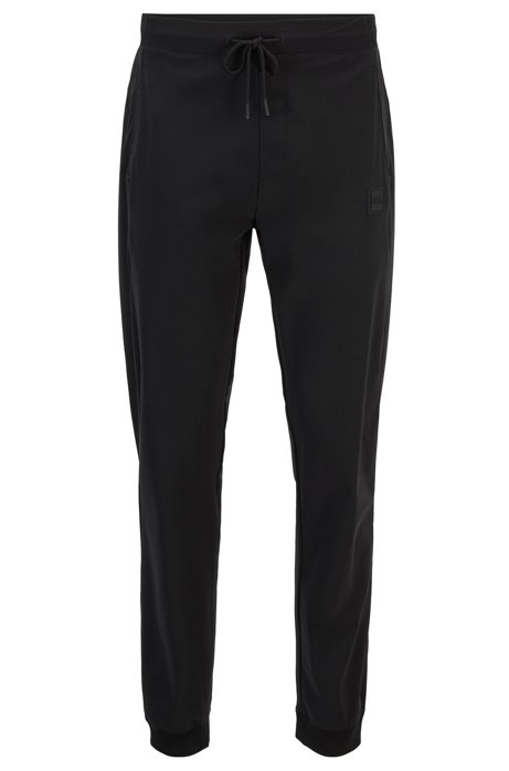 Slim-fit jogging pants in technical stretch fabric, Black