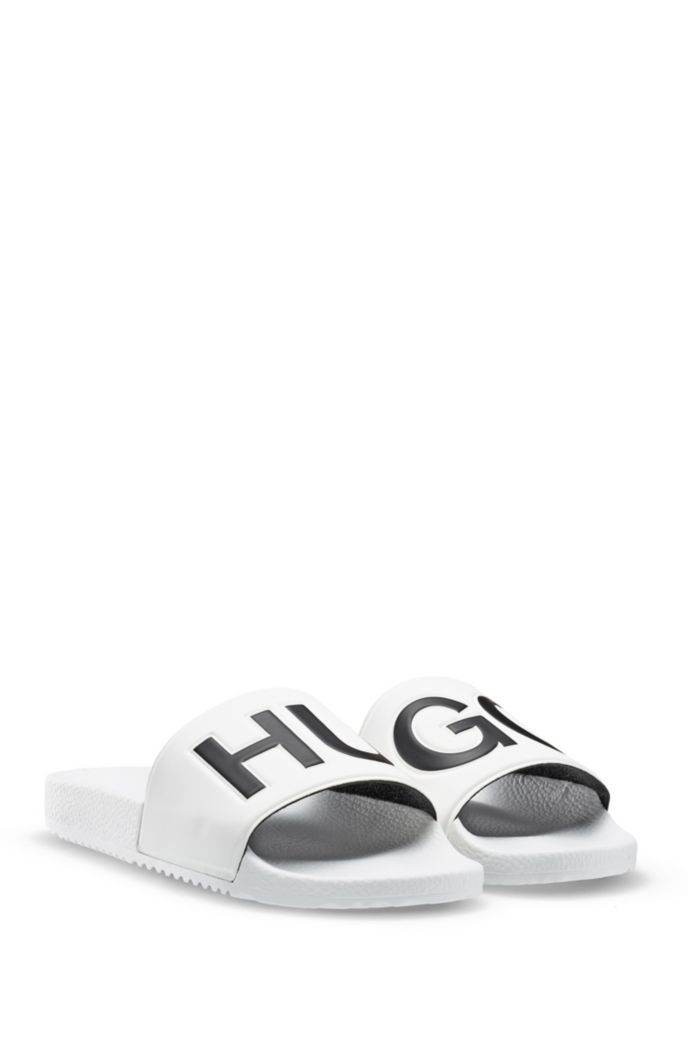 Italian-made slides with contrast-logo strap
