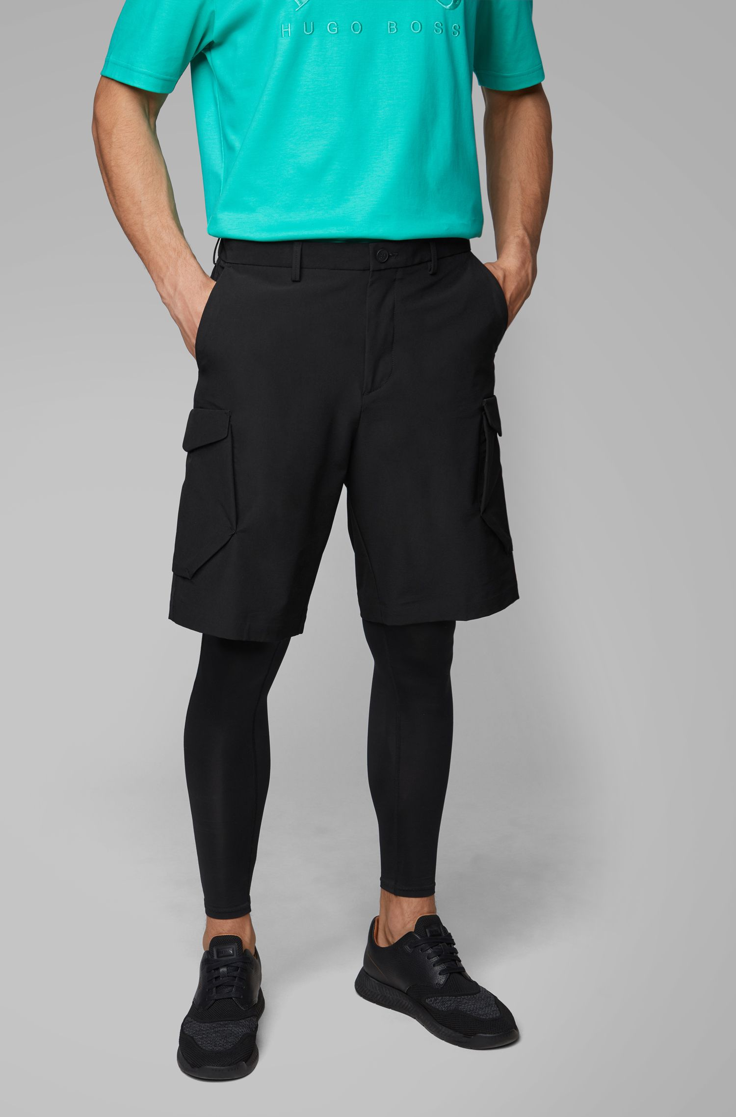 Cargo-style shorts in lightweight four-way stretch fabric, Black