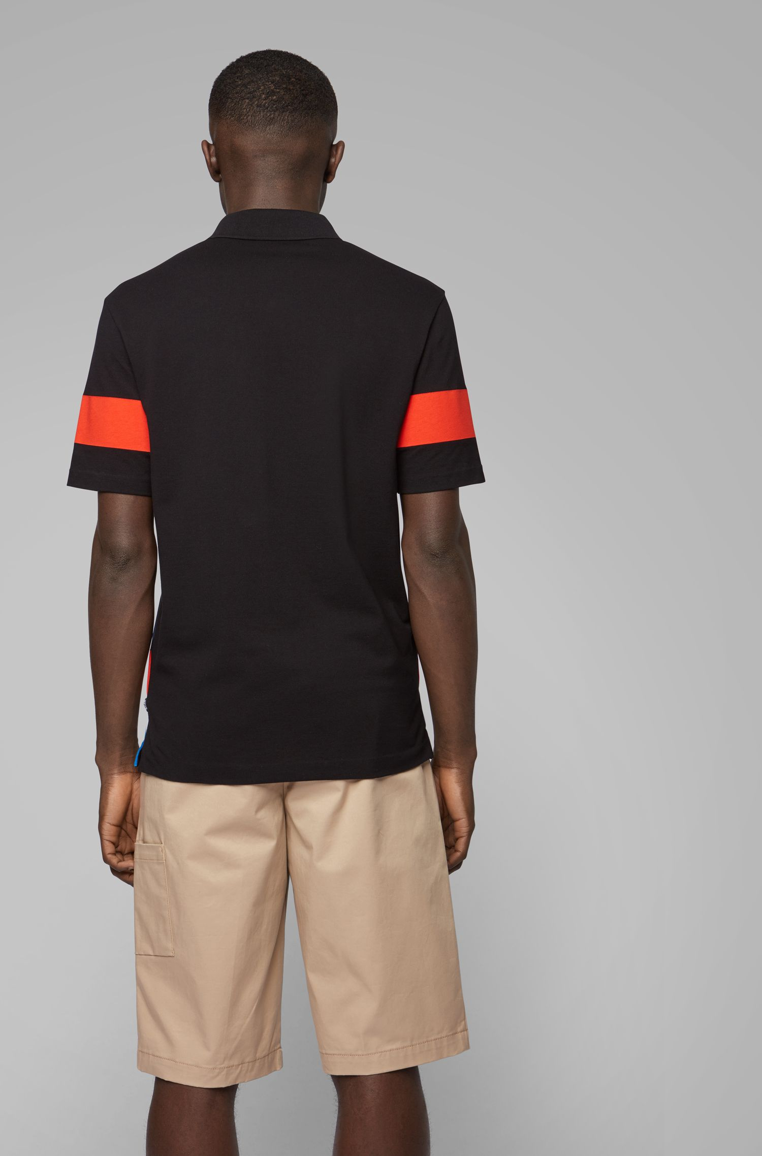 Knitted cotton piqué polo shirt with printed front panel, Black