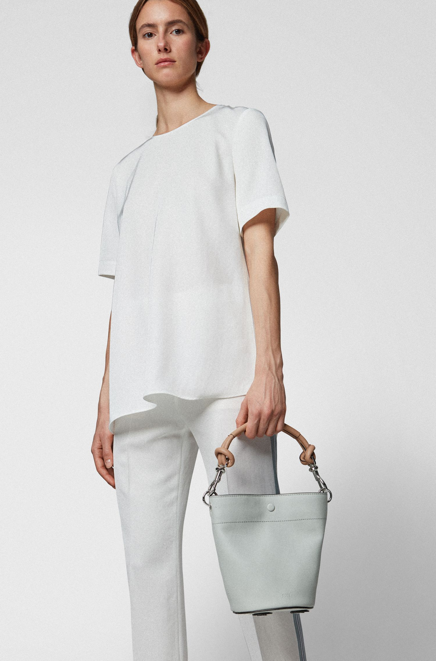 Small bucket bag in calf leather with knotted strap, Open Blue