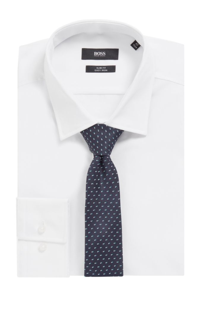 Silk tie in a patterned jacquard with logo-ribbon loop